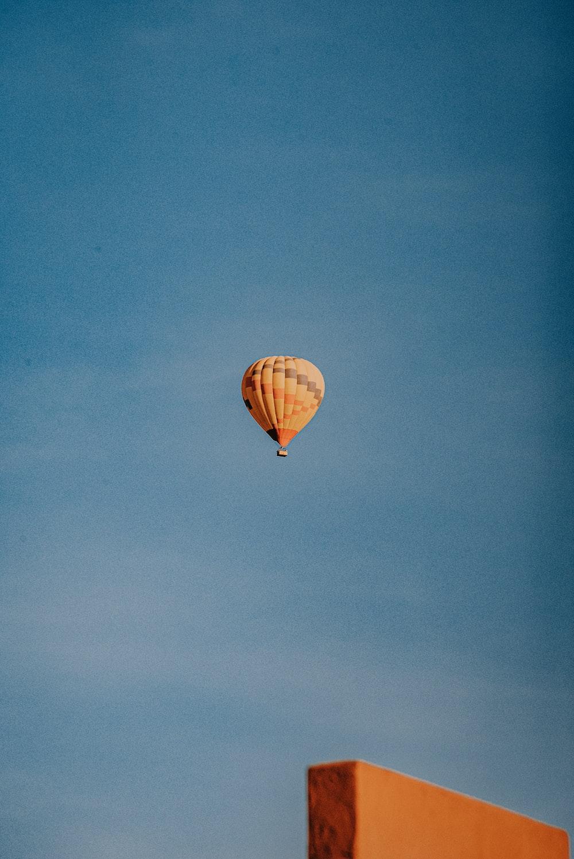 orange hot air balloon on sky