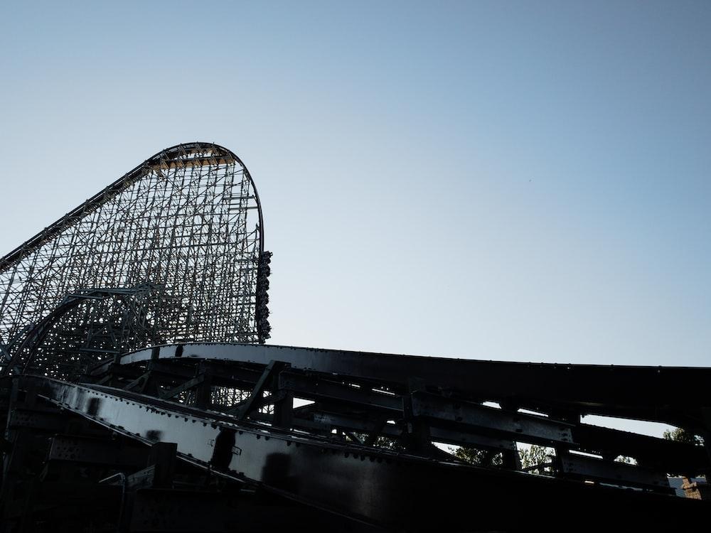black roller coaster under blue sky during daytime