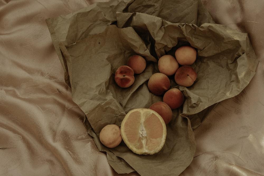 orange fruit on brown paper bag