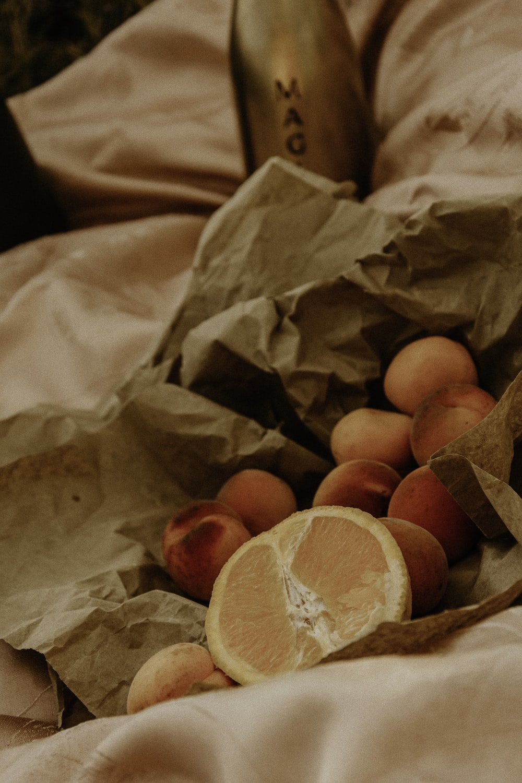 orange fruit on brown paper