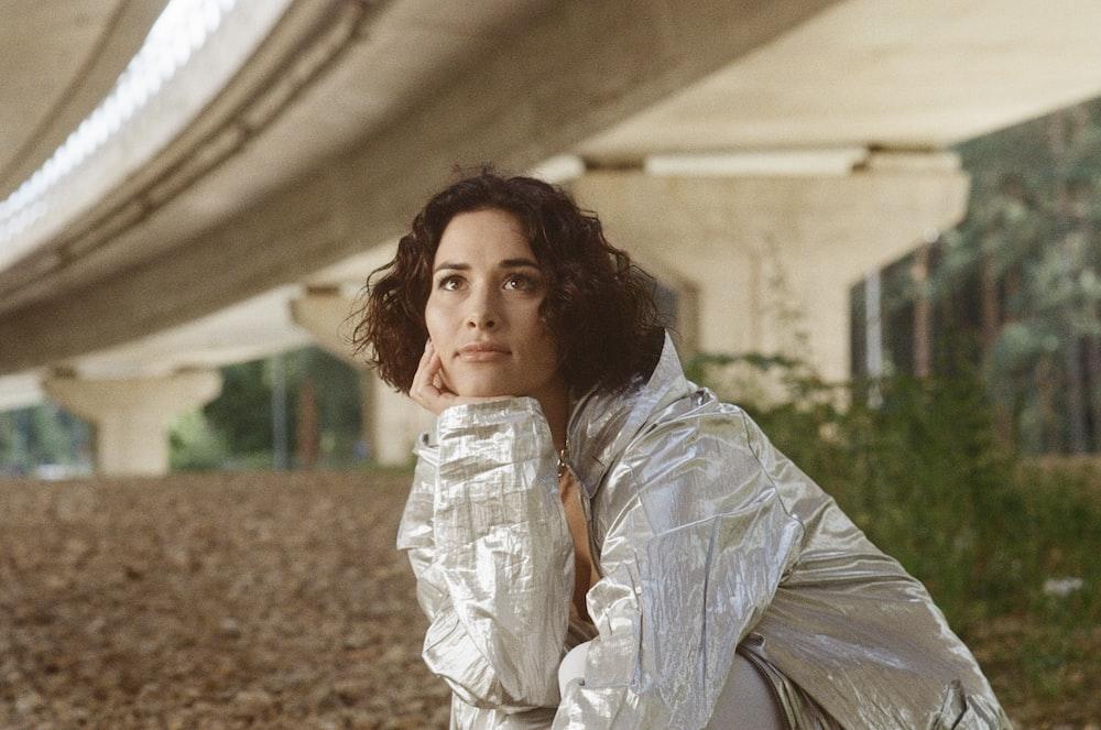 woman in white and gray dress shirt standing on brown soil during daytime, Kaspars Eglitis(@kasparseglitis)/Unsplash