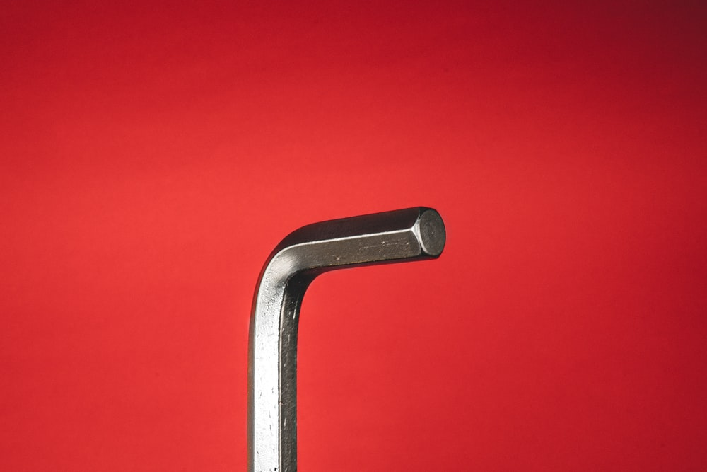 stainless steel handle bar on red background