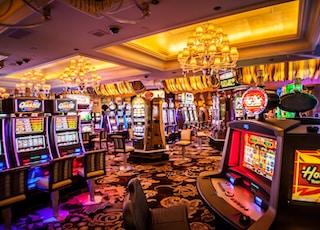 arcade machine with lights turned on inside room