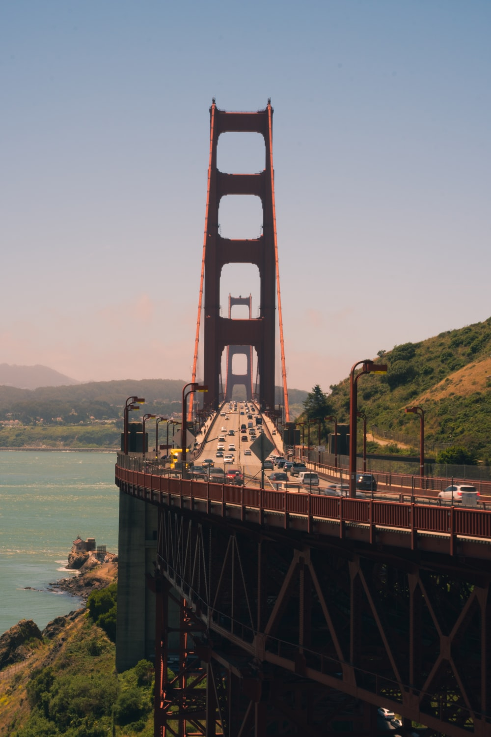 brown bridge over the sea during daytime