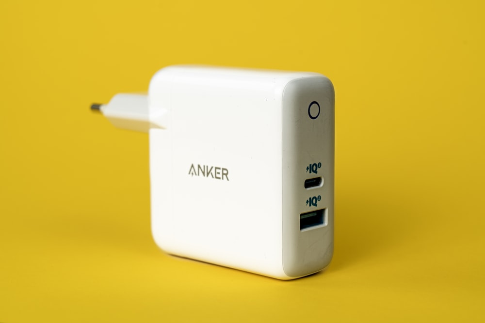 white samsung charger on yellow surface