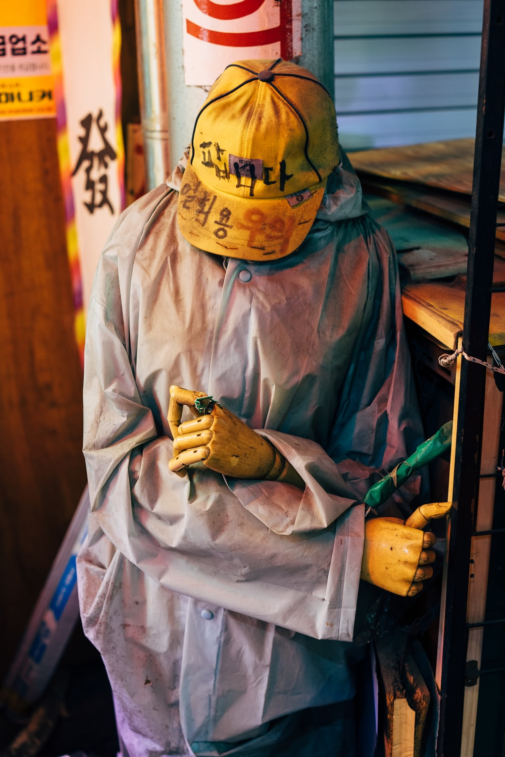 man in yellow and black fitted cap and white robe