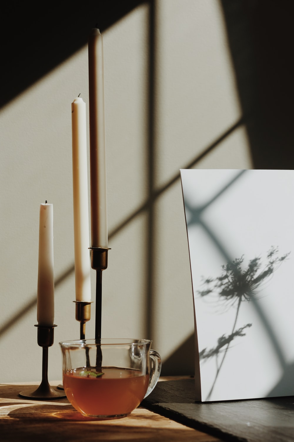 white and brown stick on glass holder