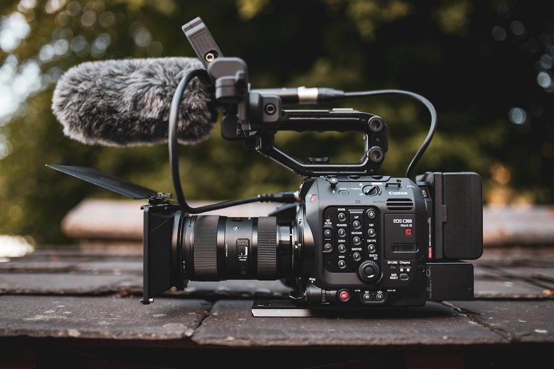 Black Dslr Camera On Brown Wooden Table - unsplash