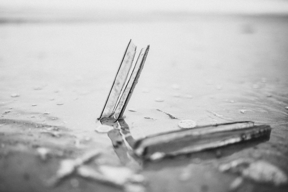 grayscale photo of a broken glass