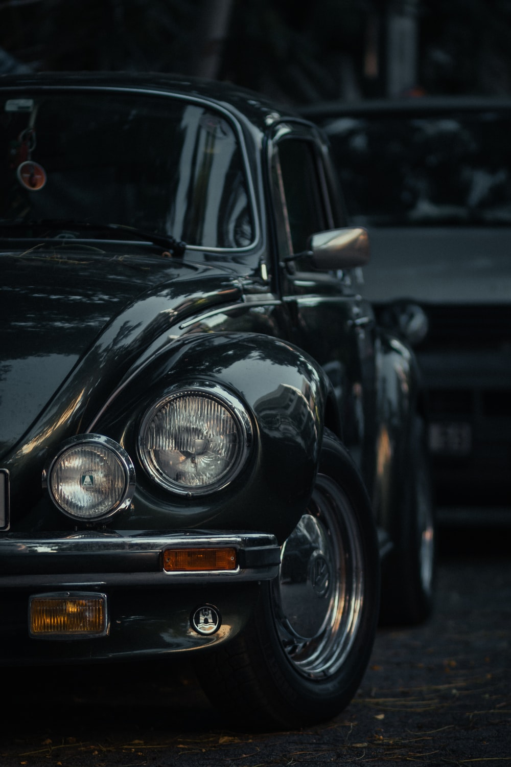 black classic car in grayscale photography