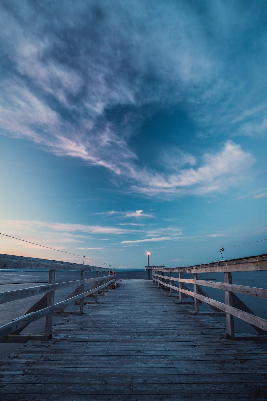 brown wooden dock under blue sky during daytime