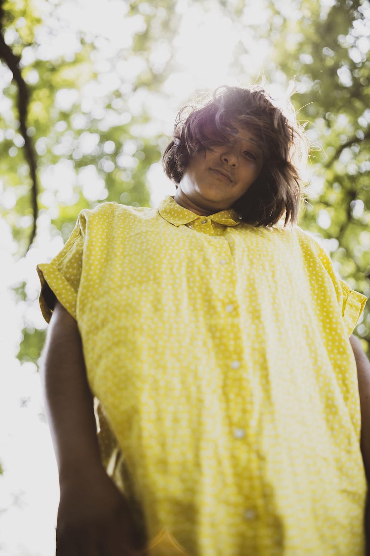 girl in yellow sleeveless dress