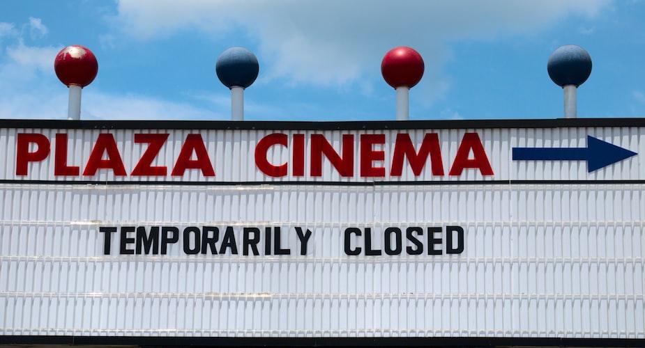 "billboard reading ""plaza cinema, temporarily closed"""