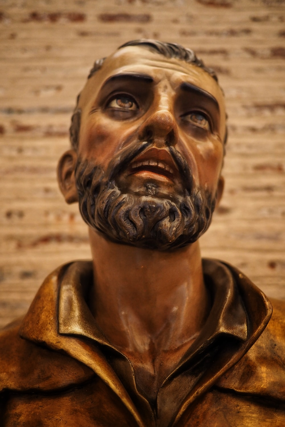 man in brown leather jacket statue