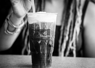 grayscale photo of clear drinking glass