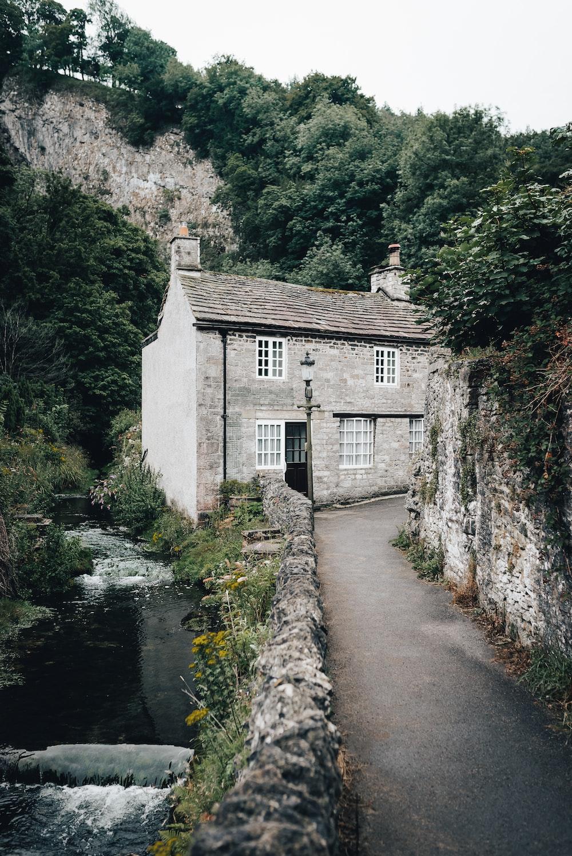 gray concrete house beside river