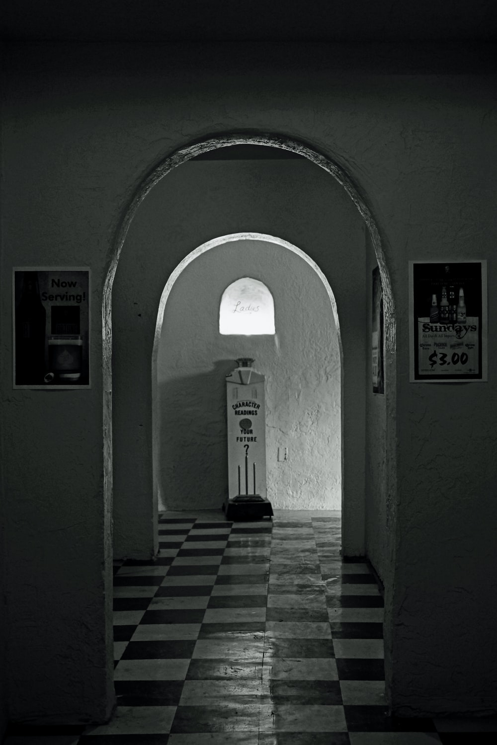 grayscale photo of hallway with no people