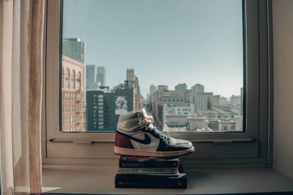 black and white nike sneakers on top of the building