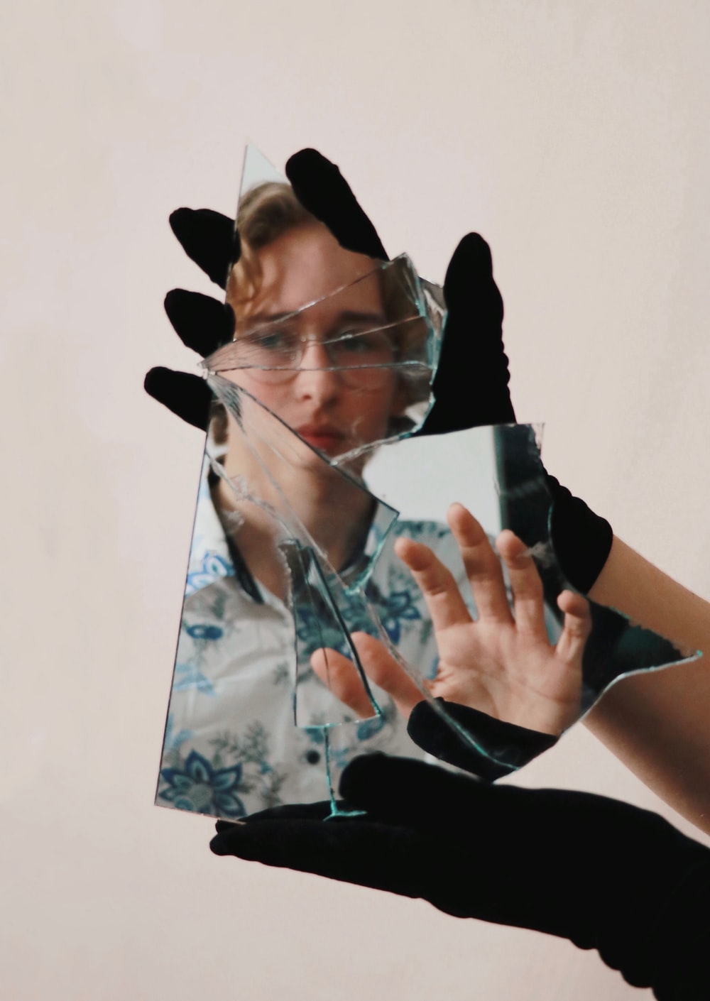 woman in black shirt covering face with hands