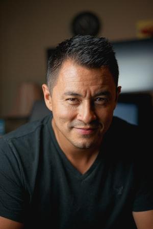 Man with dark hair smiling