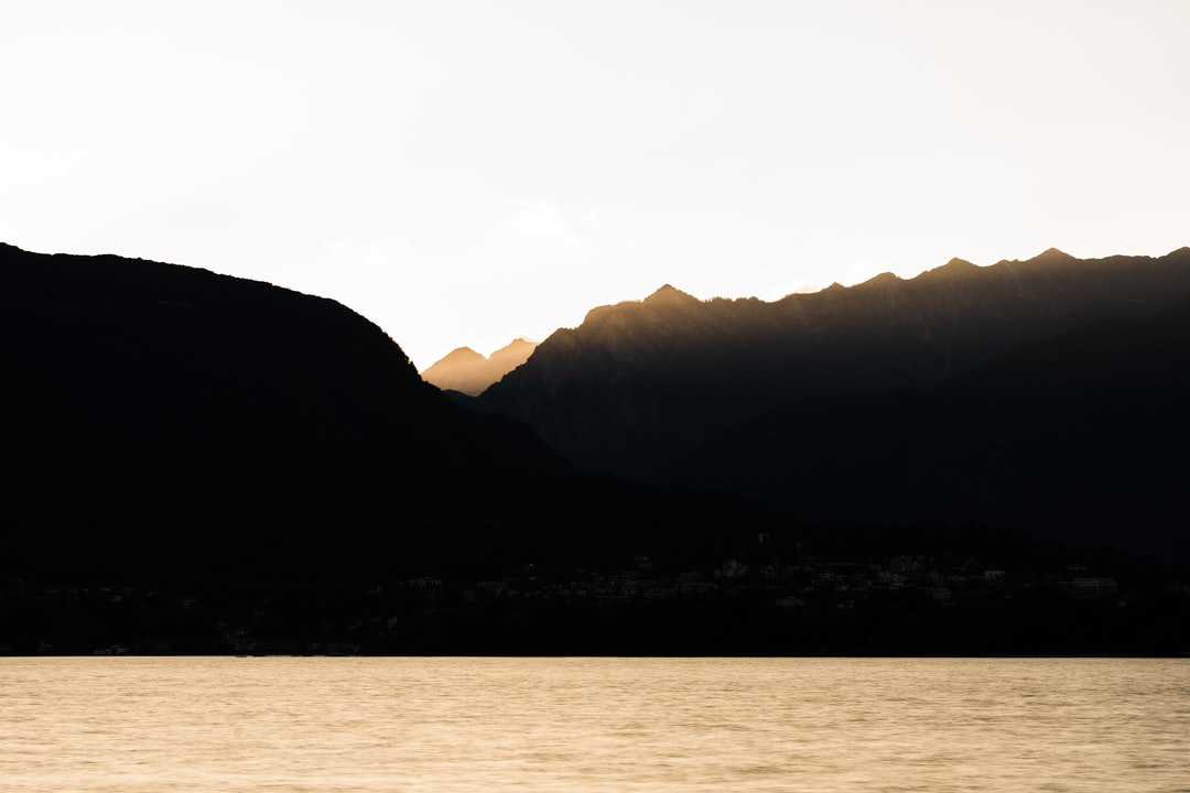 Silhouette of Mountains Near Body of Water During Daytime - unsplash
