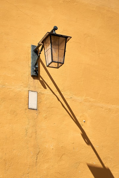 Streetlamp on house wall