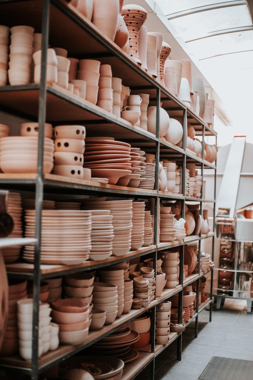 white ceramic jars on brown wooden shelf