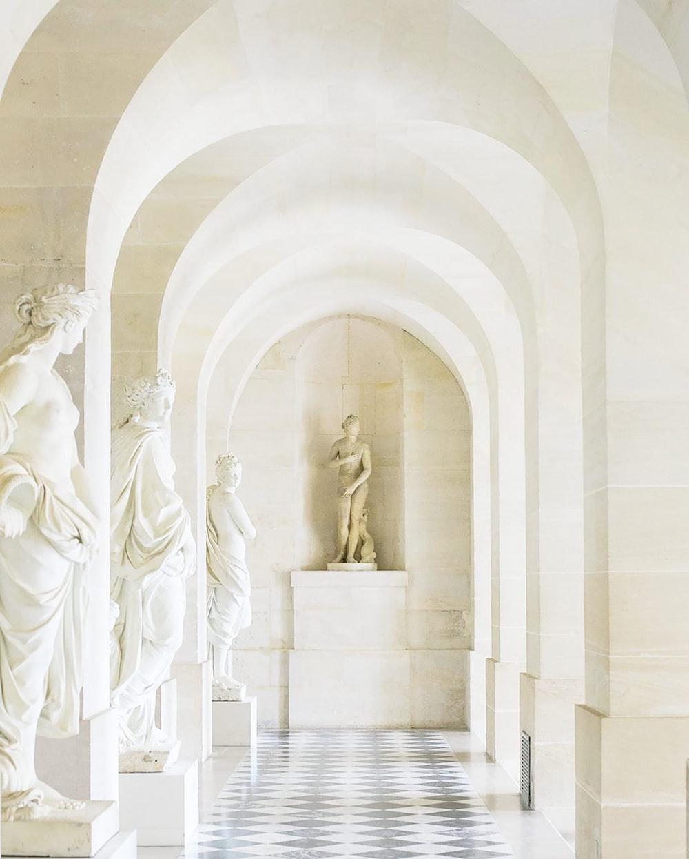 white concrete statue of a man