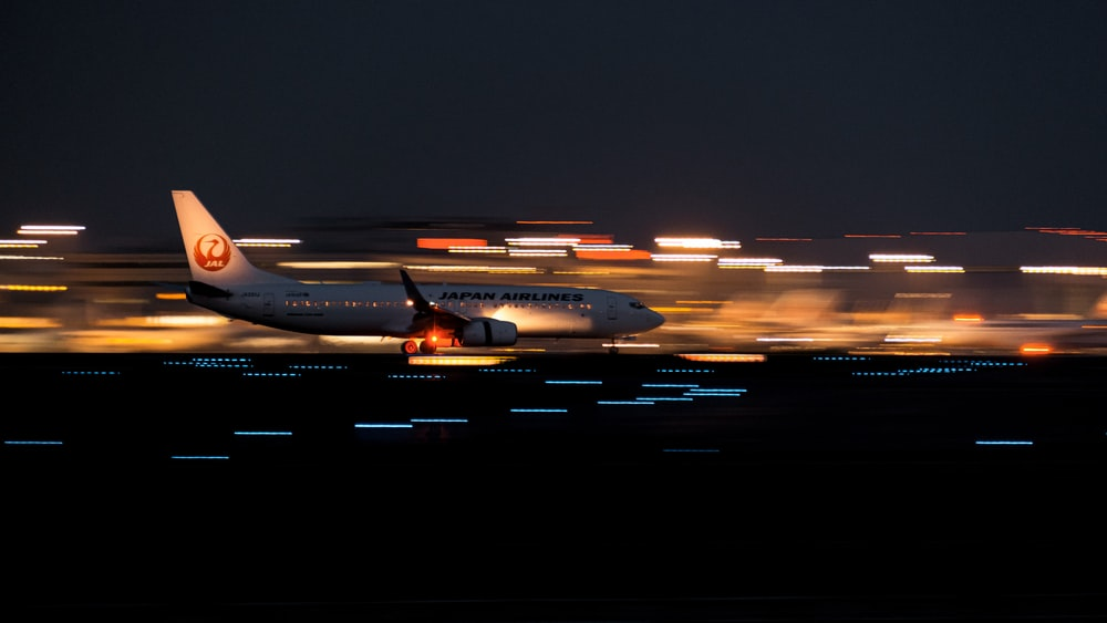 white passenger plane on airport during night time