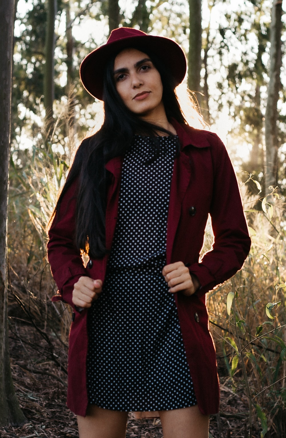 woman in red blazer and black and white polka dot dress