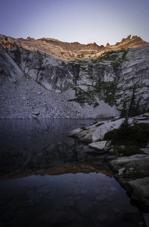 lake near trees and mountain