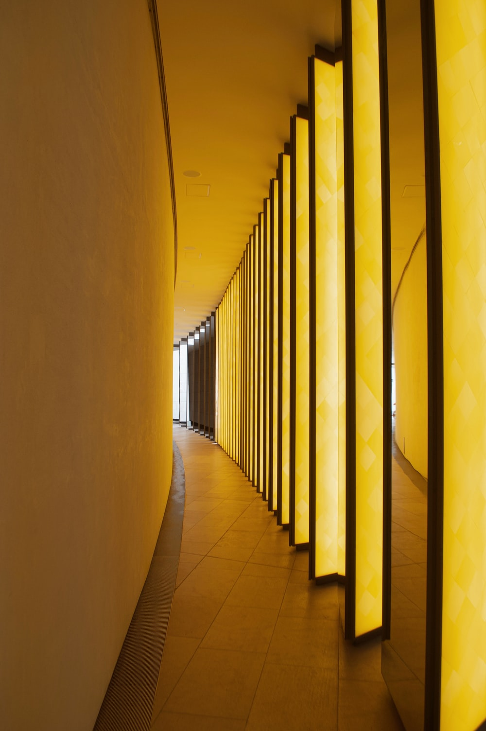 yellow hallway with white walls