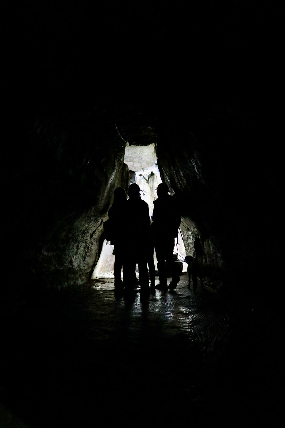 2 men in cave during daytime
