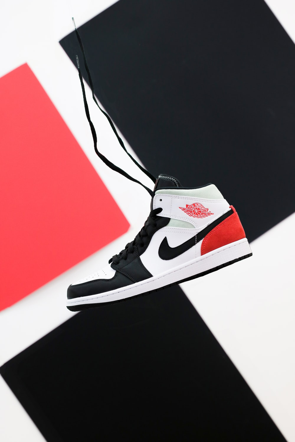 black white and red nike high top sneaker