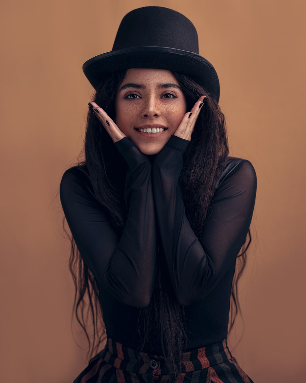 woman in black long sleeve shirt and black hat
