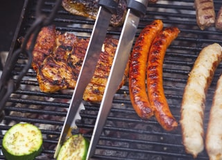 "BBQ with some original Franconian specialty ""Bratwurst"" (grilled frying sausage) steak, beef fillet and zucchini"