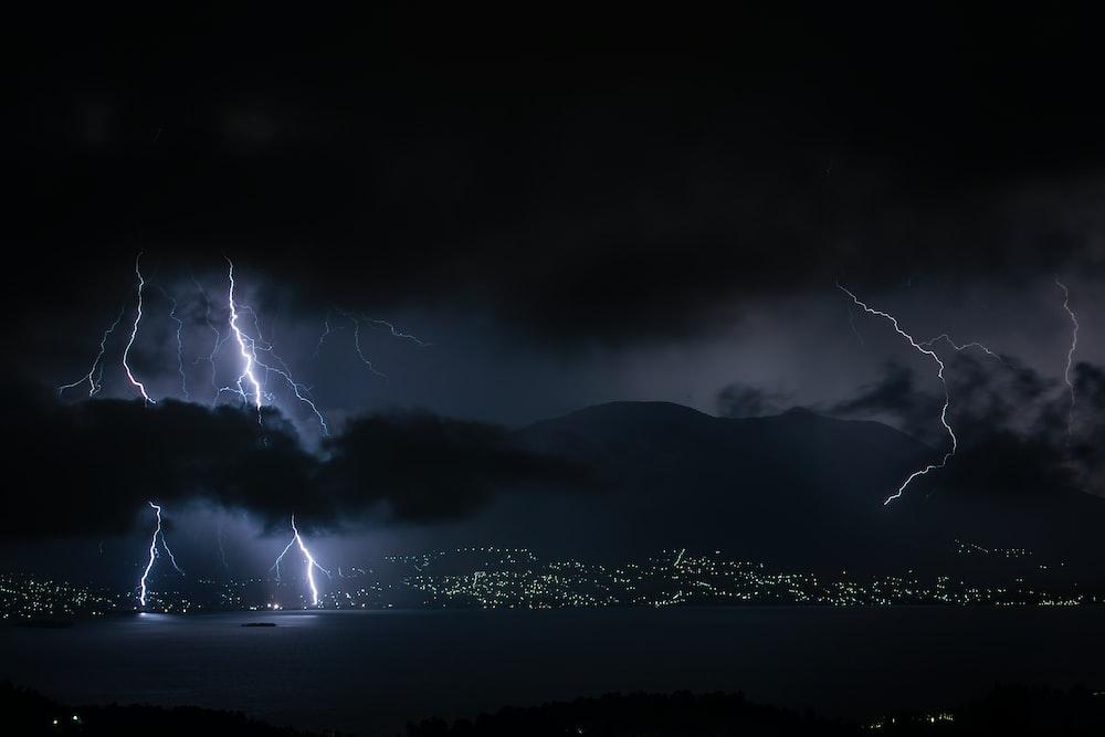 lightning strike on mountain during night time