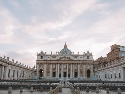 white concrete building under white clouds during daytime vatican city zoom background
