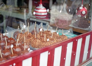 brown and white wooden candy dispenser