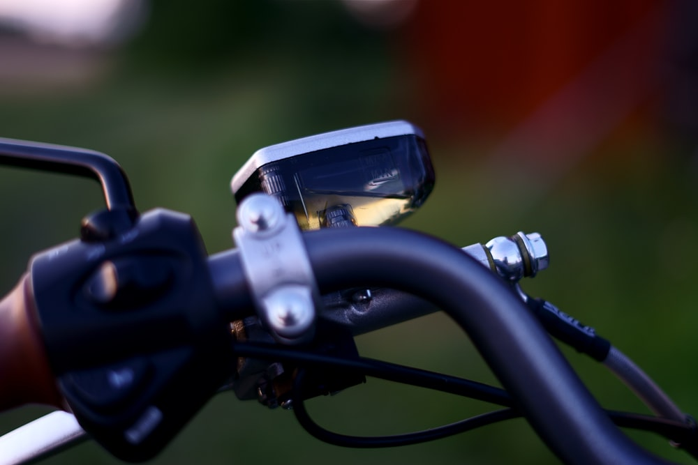 black and silver bicycle handle bar