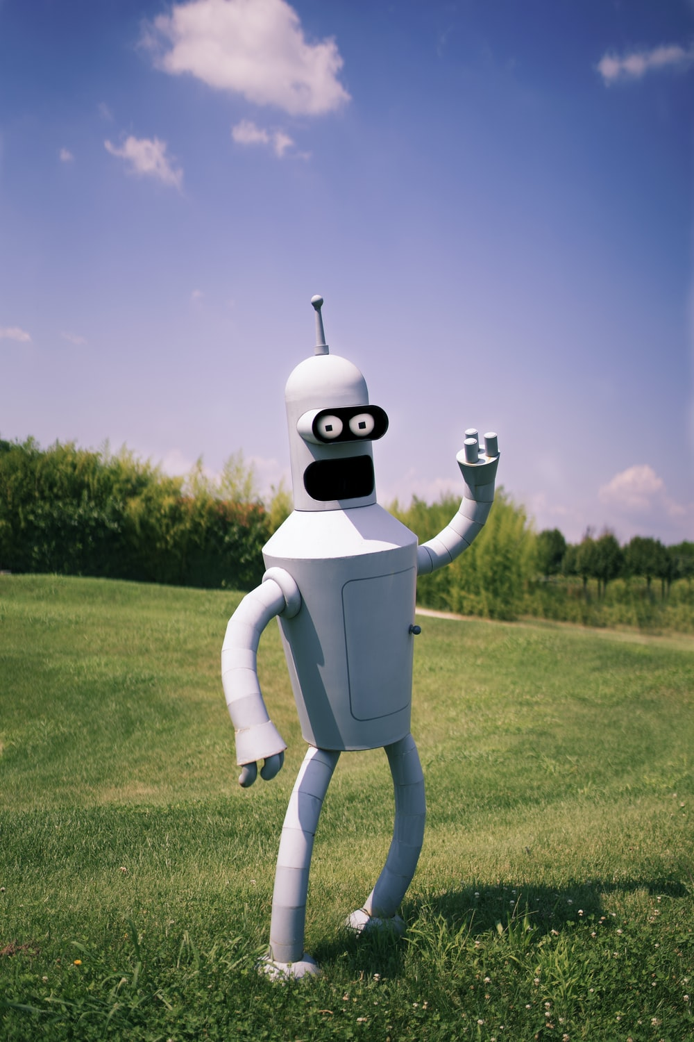 white robot on green grass field during daytime