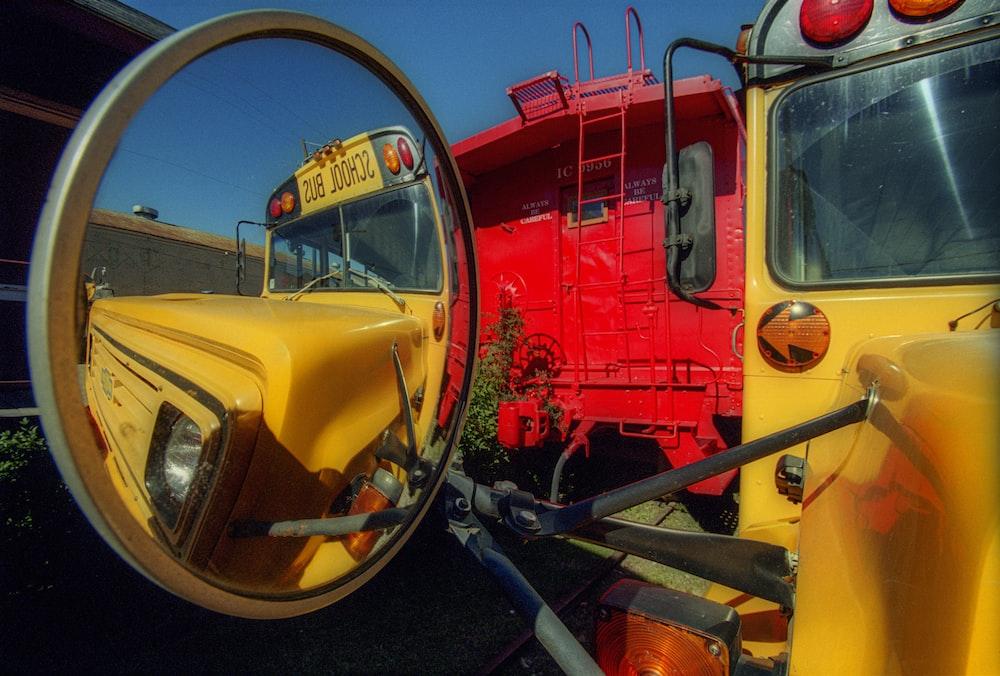 red and yellow auto rickshaw