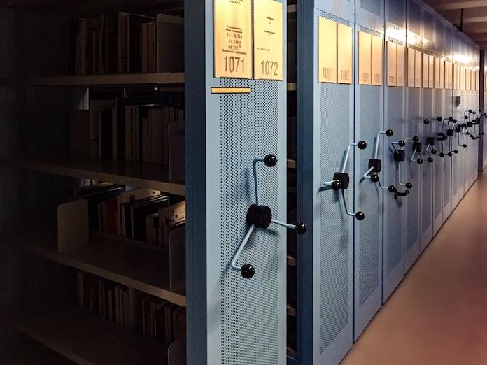 books in shelves in room