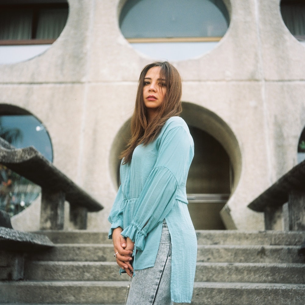 woman in gray long sleeve dress standing on stairs