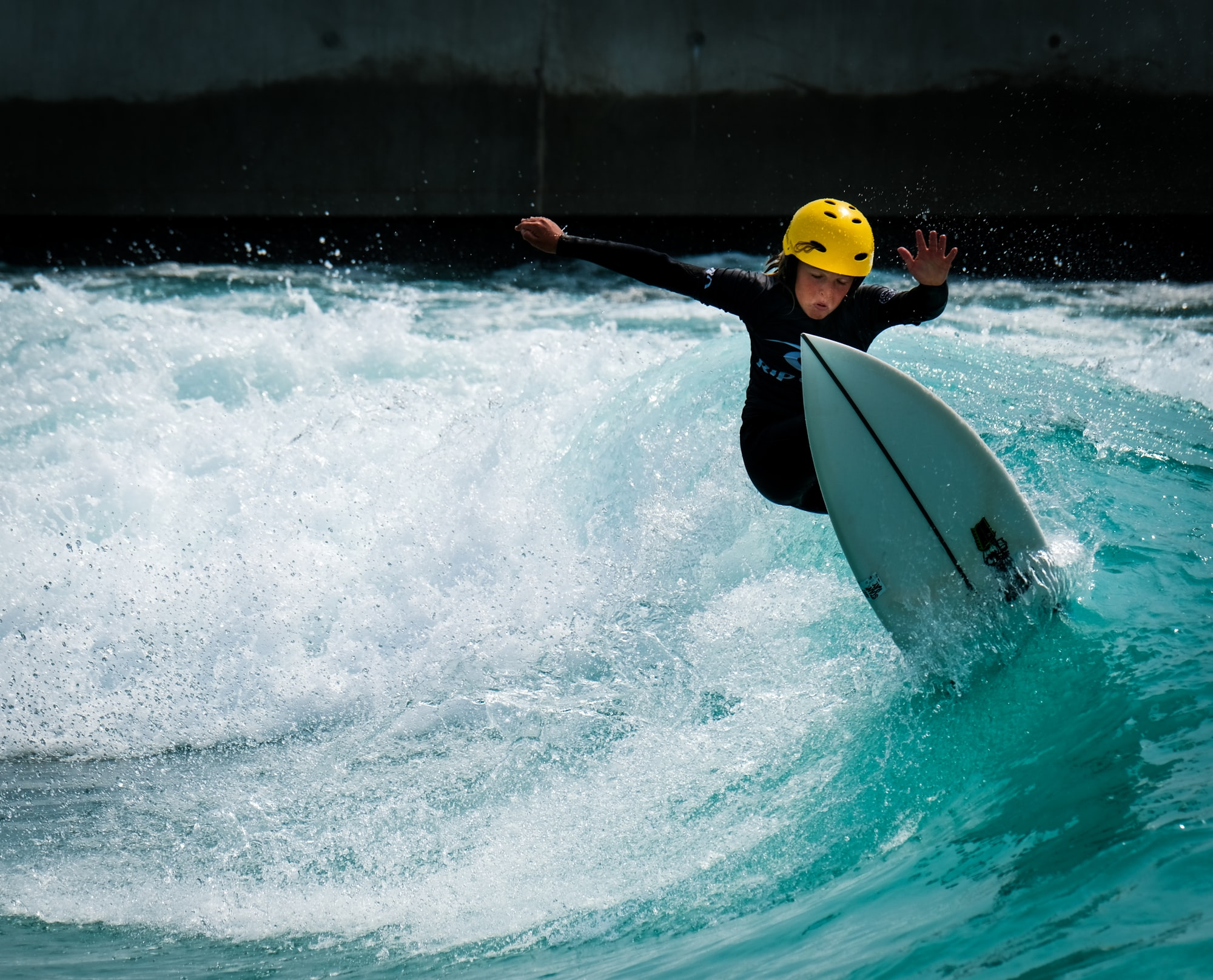 Photo of grom boy kid surfer, surfing the surf in Bristol at The Wave wavepool.