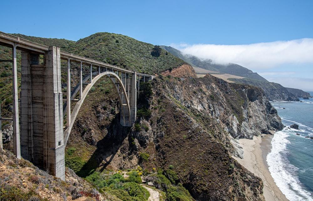 gray metal bridge over the river