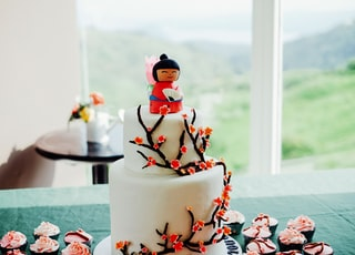 white and red snowman cake