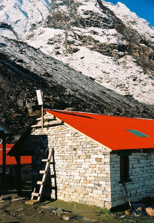 brown brick house near mountain during daytime