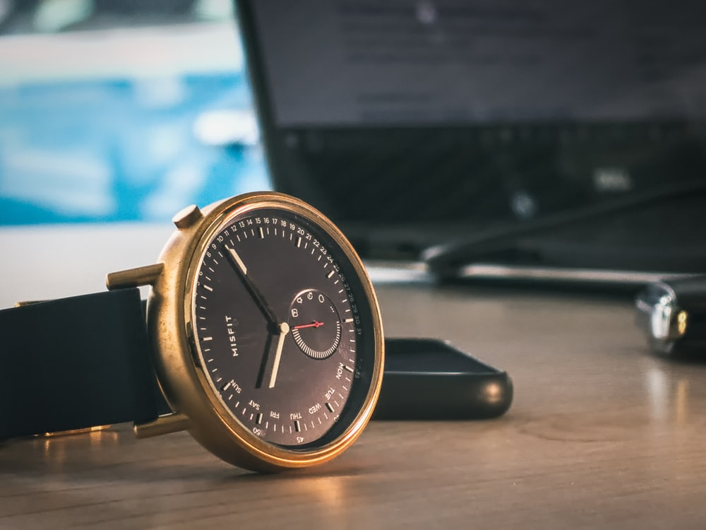 gold and black analog watch