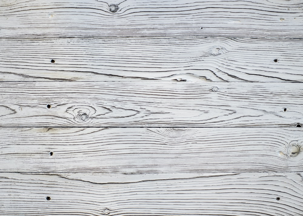 white and gray wooden surface